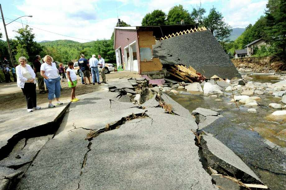 Officials and residents view the swollen Gulf Brook on Tuesday, Aug. 30, 2011, in Keene, N.Y. The brook took out the road and the Keene Fire Department firehouse. (Cindy Schultz / Times Union) Photo: Cindy Schultz