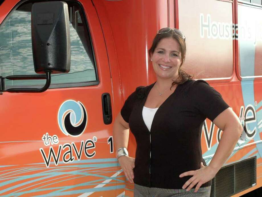The Houstom Wave, owner, Lauren Barrash, stand in front of the buses. Photo: George Wong / Freelance