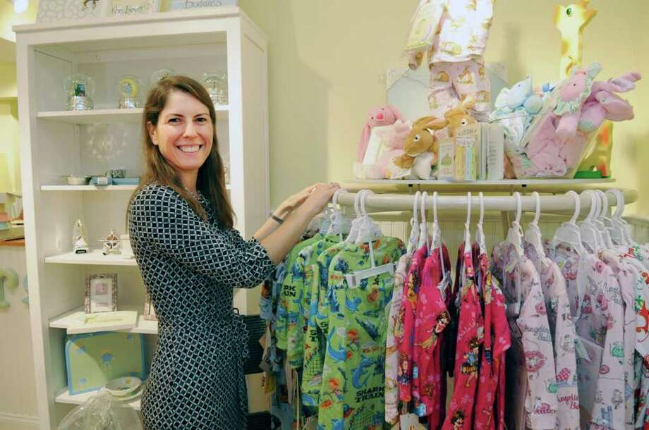 Sonia Malloy owner of Splurge at 39 Lewis St., in Greenwich, is opening another shop, Splurge Kids, at 60 Lewis St. She stands in the new Splurge Kids store on Tuesday, Aug. 30, 2011. Photo: Helen Neafsey / Greenwich Time