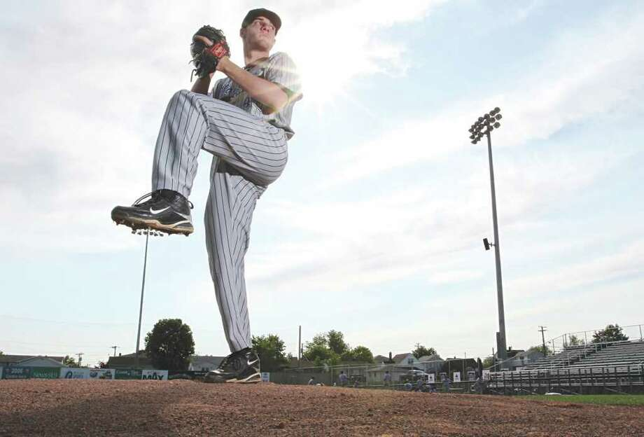 Moncton Mets pitcher Ryan Healy works on his delivery. Healy of Westport has been one of Moncton's top hurlers this summer. Photo: Cole Burston / Times & Transcrip