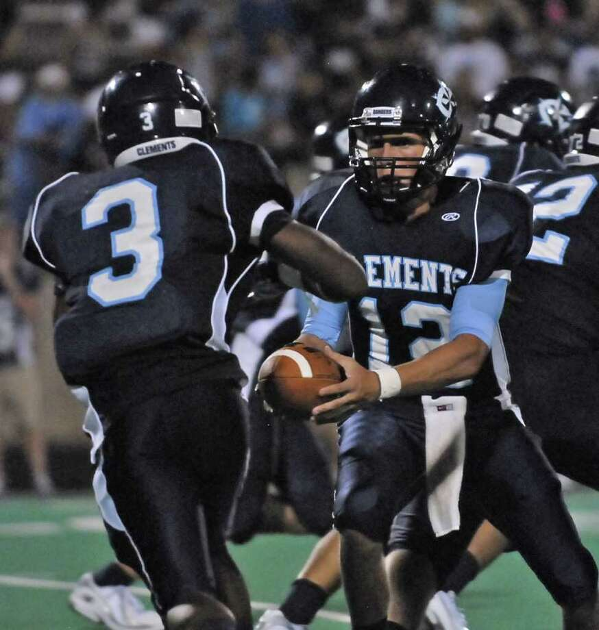 Lawrenzo Minor (#3) from Clements takes the handoff from quarterback Clayton Holgorsen (#12) in the second half of their game with La Porte Saturday 8/27/11. Photo by Tony Bullard. Photo: Tony Bullard / Credit: for the Chronicle