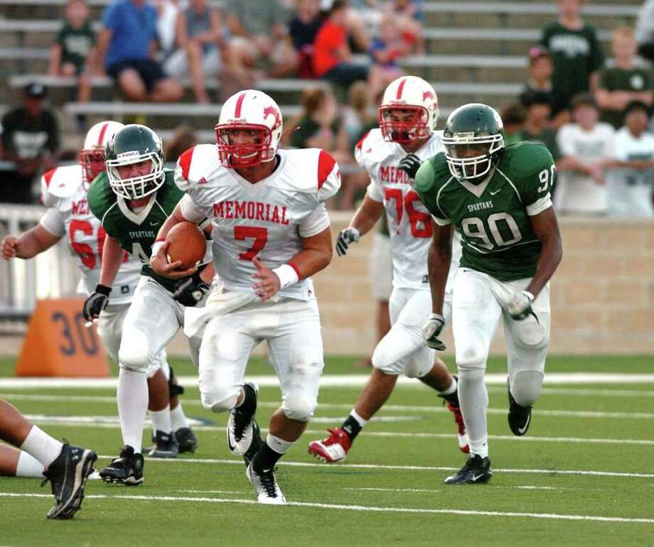 Stratford and Memorial High Schools met at Tully stadium  8-25-11 for a football game.      Memorial scored a 14-0 victory over it's rival Stratford.   Memorial's quarterback #7 Tyler McCloskey runs away from the defense of Stratford.  Eddy Matchette Photo: Eddy Matchette, Freelance / freelance