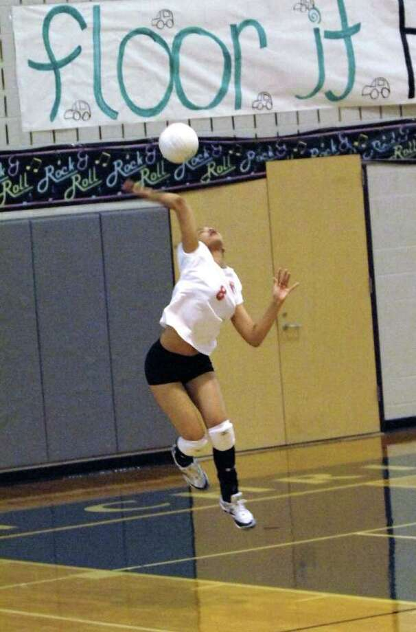Incarnate Word visited Houston Christian High School for a volleyball match on 9-16-2010.   77002, 77043 Using her jump serve against Houston Christian is Incarnate Word's Kyrena Dudley. Photo Eddy Matchette Photo: Eddy Matchette, Freelance / freelance