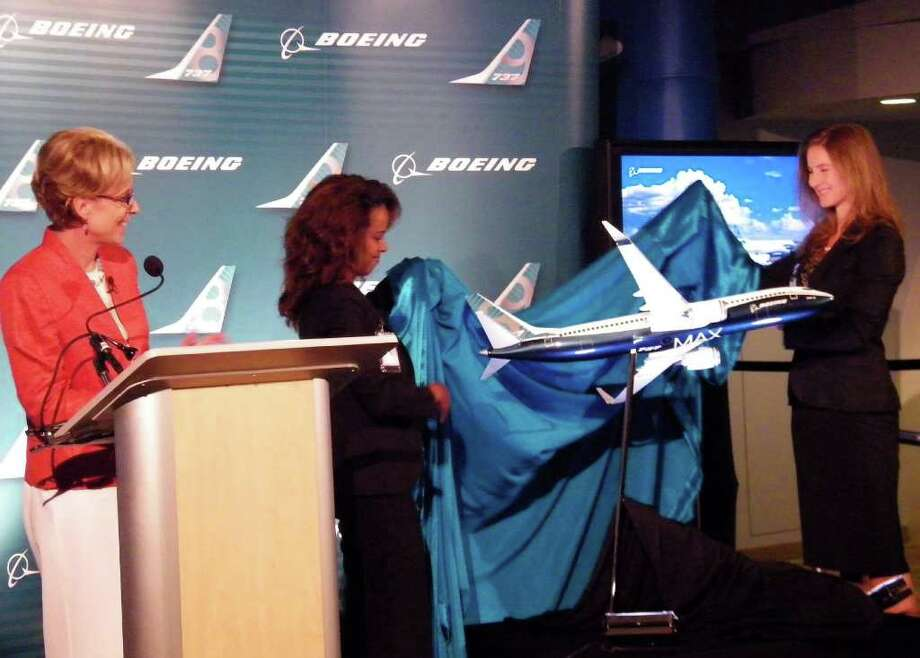 Nicole Piasecki, vice president of Business Development & Strategic Integration for Boeing Commercial Airplanes, looks on during the unveiling of a model of the new Boeing 737 MAX 8 during the company's announcement of the re-engining program on Tuesday, Aug. 30, 2011 in Renton, Wash. Photo: Aubrey Cohen/seattlepi.com