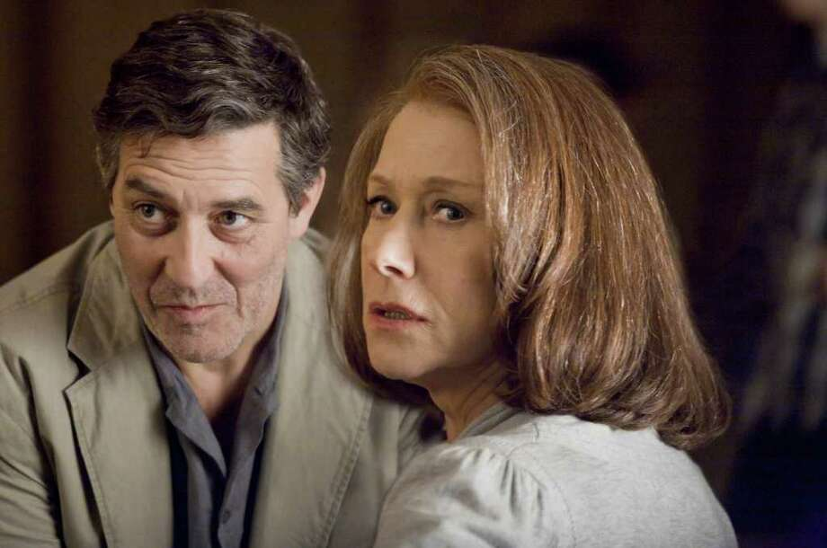 """In this film image released by Focus Features, Ciarán Hinds, left, and Helen Mirren are shown in a scene from the espionage thriller """"The debt."""" (AP Photo/Focus Features, Laurie Sparham) Photo: Laurie Sparham, HONS / 2011 Focus Features"""