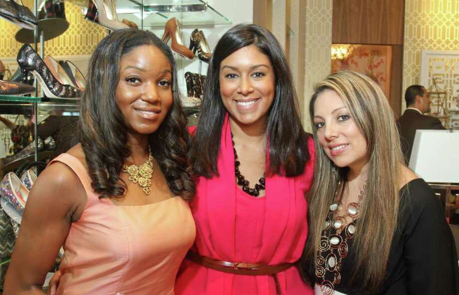 (For the Chronicle/Gary Fountain, August 25, 2011) Tiffany Johnson, from left, Jamie Rugama and Karen Lix at the Elaine Turner Boutique, where accessories designer Elaine Turner debuted her Fall 2011 collection with TUTS Leading Ladies. Twenty percent of all stiletto sales benefit the Pink Stiletto Fund. Photo: Gary Fountain, Freelance / Copyright 2011 Gary Fountain Telephone:  281-531-0260
