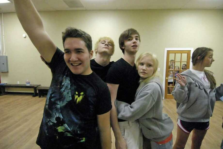 Tyler Galindo (19) Jordan McLaughlin (18) Mark Jammal (16) Lindsey Vrana (16) and at right Jelena Galagaza (cq) (14) rehearse the musical Kissless at the Houston Family Arts Center Thursday 8/18/11. Photo by Tony Bullard. Photo: Tony Bullard / Credit: for the Chronicle