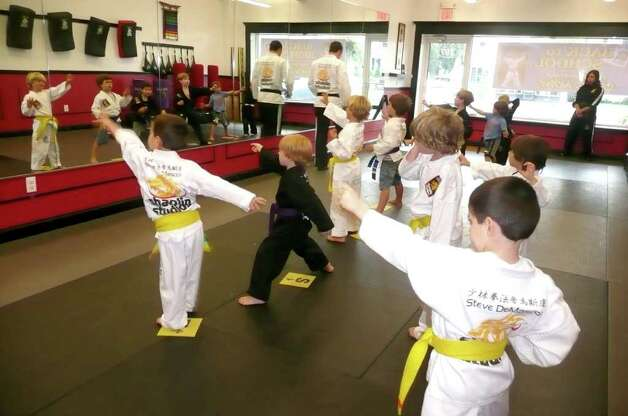 The Tigers class, made up of local 4- to 6-year-olds, perform their tiger claw movement at Shaolin Studio in Cos Cob. Photo: Anne W. Semmes