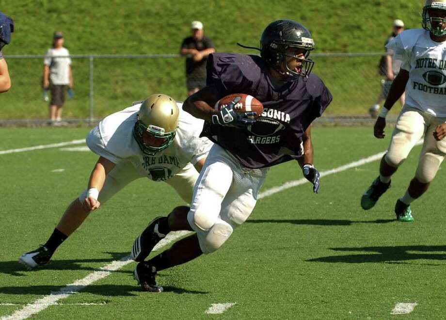 Ansonia's Arkeel Newsome carries the ball during football scrimage action against Notre Dame of West Haven at Veterans Field in West Haven, Conn. on Tuesday August 30, 2011. Photo: Christian Abraham / Connecticut Post