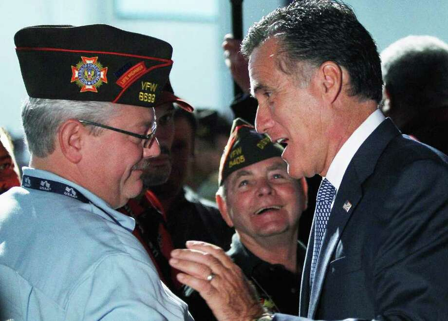 Republican presidential candidate, former Massachusetts Gov. Mitt Romney, right, greets veterans after he addressed the Veterans of Foreign Wars 112th National Conference, Tuesday, Aug. 30, 2011, in San Antonio. (AP Photo/Eric Gay) Photo: Eric Gay, STF / AP