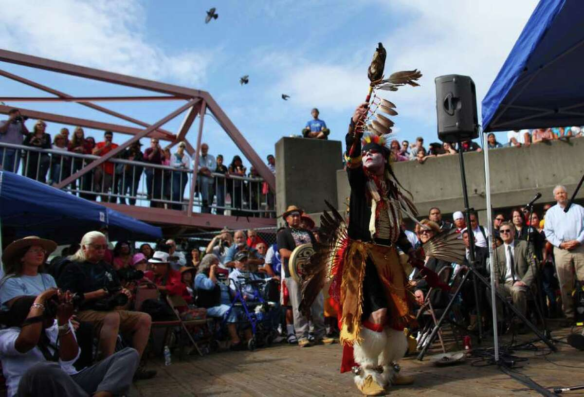 Native dancer Nikk Dakota performs a dance honoring John T. Williams on Tuesday, August 30, 2011 at Waterfront Park on Pier 57 in downtown Seattle. Totem poles carved in honor of John T. Williams, killed in 2010 by Seattle Police officer Ian Birk, were blessed during the ceremony.