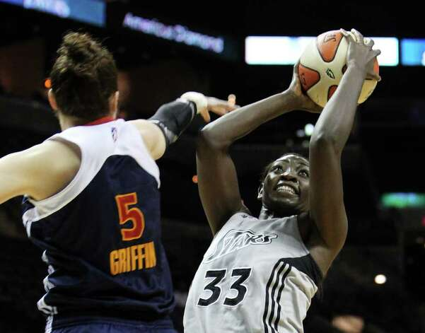 Silver Stars' Sophia Young (33) attempts a shot against Connecticut Suns' Kelsey Griffin (05) during the first half at the AT&T Center on Tuesday, August 30, 2011. Kin Man Hui/kmhui@express-news.net Photo: KIN MAN HUI, -- / SAN ANTONIO EXPRESS-NEWS (NFS)