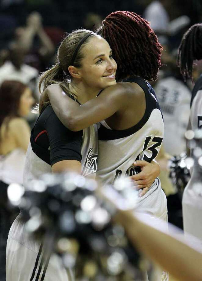 Silver Stars' Becky Hammon (25) gets a hug from teammate Danielle Robinson (13) after the Silver Stars defeated the Connecticut Sun, 78-66, at the AT&T Center on Tuesday, August 30, 2011. Hammon scored 16 points to surpass the 5,000 career point mark. Kin Man Hui/kmhui@express-news.net Photo: KIN MAN HUI, -- / SAN ANTONIO EXPRESS-NEWS (NFS)