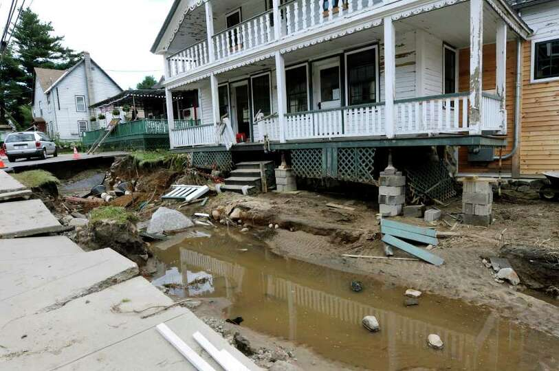 A home along Route 9N is without a front yard on Tuesday, Aug. 30, 2011, in Keene, N.Y. (Cindy Schul