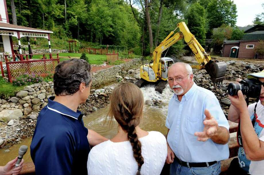 Town of Keene Supervisor Bill Ferebee, right, shows Gov. Andrew Cuomo, left, and his daughter Mariah Kennedy Cuomo, 16, rubble being removed from Gulf Brook on Tuesday, Aug. 30, 2011, in Keene, N.Y. (Cindy Schultz / Times Union) Photo: Cindy Schultz