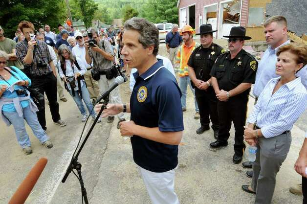 Gov. Andrew Cuomo, center, talks about rebuilding the Town of Keene during a news conference on Tuesday, Aug. 30, 2011, in Keene, N.Y. At right are Assemblywoman Teresa Sayward and Congressman Chris Gibson. (Cindy Schultz / Times Union) Photo: Cindy Schultz