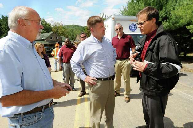 Town of Keene Supervisor Bill Ferebee, left, and Congressman Chris Gibson, center, talk with Andrew Feeney, State Emergency Management director, on Tuesday, Aug. 30, 2011, in Keene, N.Y. (Cindy Schultz / Times Union) Photo: Cindy Schultz