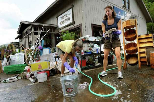 Residents Barbara Kausman, left, and Samantha Robinson help clean up the flooded general store on Tuesday, Aug. 30, 2011, at McDonough's Valley Hardware in Keene Valley, N.Y. (Cindy Schultz / Times Union) Photo: Cindy Schultz