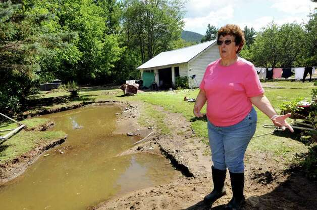 Resident Kathy House talks about the beautiful garden she used to have in her backyard on Tuesday, Aug. 30, 2011, in Keene Valley, N.Y. (Cindy Schultz / Times Union) Photo: Cindy Schultz