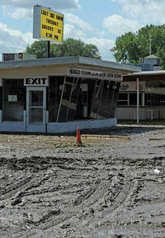 The parking lot of Jumpin Jacks in Scotia, N.Y. Aug 30, 2011 shows the evidence of the flooding that occurred yesterday.  (Skip Dickstein/ Times Union) Photo: Skip Dickstein / 00014452A
