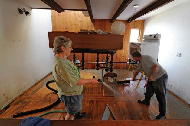 Clean up continues for Darlene Duggan and her son-in-law Ben Houlihan at 18 North Street in the Stockade section of Schenectady, N.Y. Aug 30, 2011.    (Skip Dickstein/ Times Union) Photo: Skip Dickstein / 00014452A