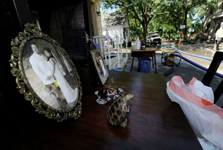 A wedding photo sits on a table outside 27 North Street as Clean up continues in the Stockade sectio