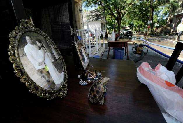 A wedding photo sits on a table outside 27 North Street as Clean up continues in the Stockade section of Schenectady, N.Y. Aug 30, 2011.    (Skip Dickstein/ Times Union) Photo: Skip Dickstein / 00014452A