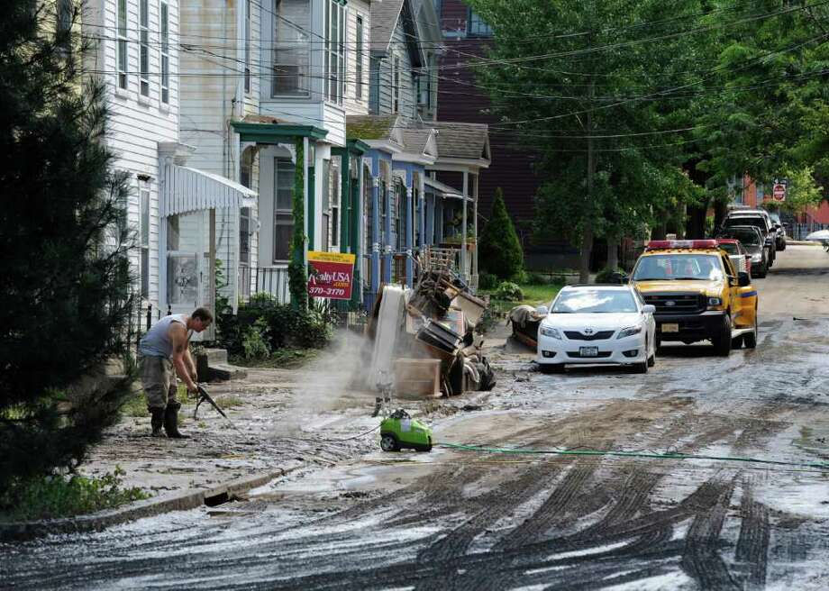 Clean up continues on N. Ferry Street in the Stockade section of Schenectady, N.Y. Aug 30, 2011.    (Skip Dickstein/ Times Union) Photo: Skip Dickstein / 00014452A