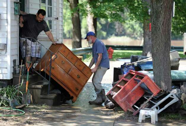 Clean up continues for Hector Ramirez, right and his landlord Dennis Meyer at 31 North Street in the Stockade section of Schenectady, N.Y. Aug 30, 2011.    (Skip Dickstein/ Times Union) Photo: Skip Dickstein / 00014452A
