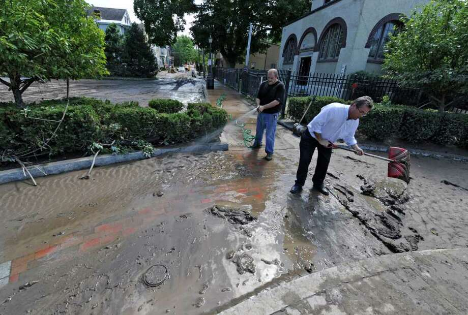 Carl Olsen, Commissioner of OGS City of Schenectady, right and Andrew Coppola of Violia Water clean the walkway near the pumping station in the Stockade section of Schenectady, N.Y. Aug 30, 2011.    (Skip Dickstein/ Times Union) Photo: Skip Dickstein / 00014452A