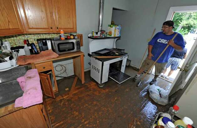 Gave Marruso works on cleaning 120 N. Ferry  Street in the Stockade section of Schenectady, N.Y. Aug 30, 2011.    (Skip Dickstein/ Times Union) Photo: Skip Dickstein / 00014452A