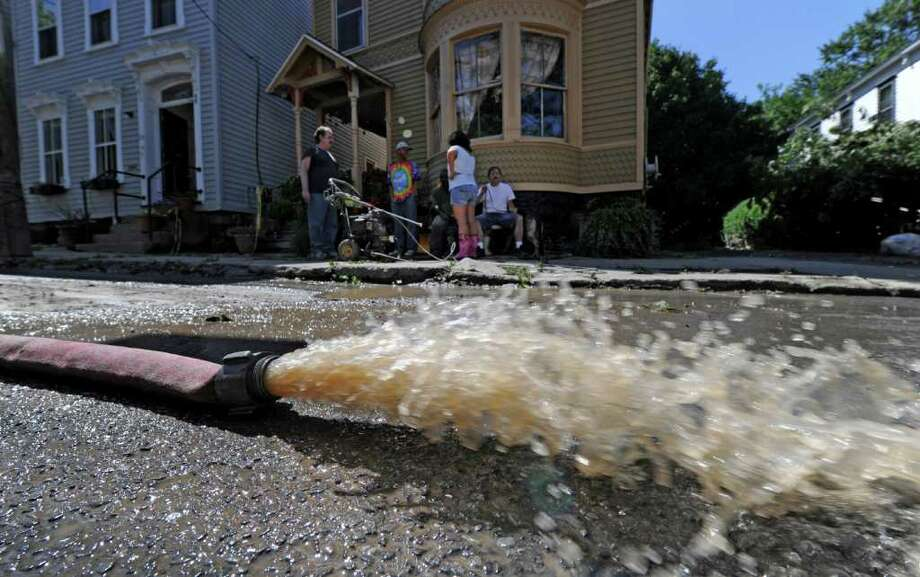 Clean up continues for residents of N. Ferry  Street in the Stockade section of Schenectady, N.Y. as water is pumped from a nearby basement Aug 30, 2011.    (Skip Dickstein/ Times Union) Photo: Skip Dickstein / 00014452A