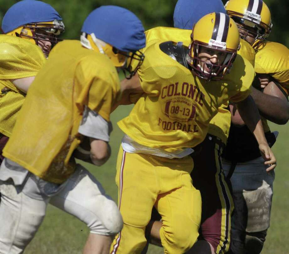 Colonie High School football player Giancarlo Sainato, right, moves in to tackle a teammate  during drills at practice on Tuesday, Aug. 30, 2011. (Paul Buckowski / Times Union) Photo: Paul Buckowski  / 00014449A