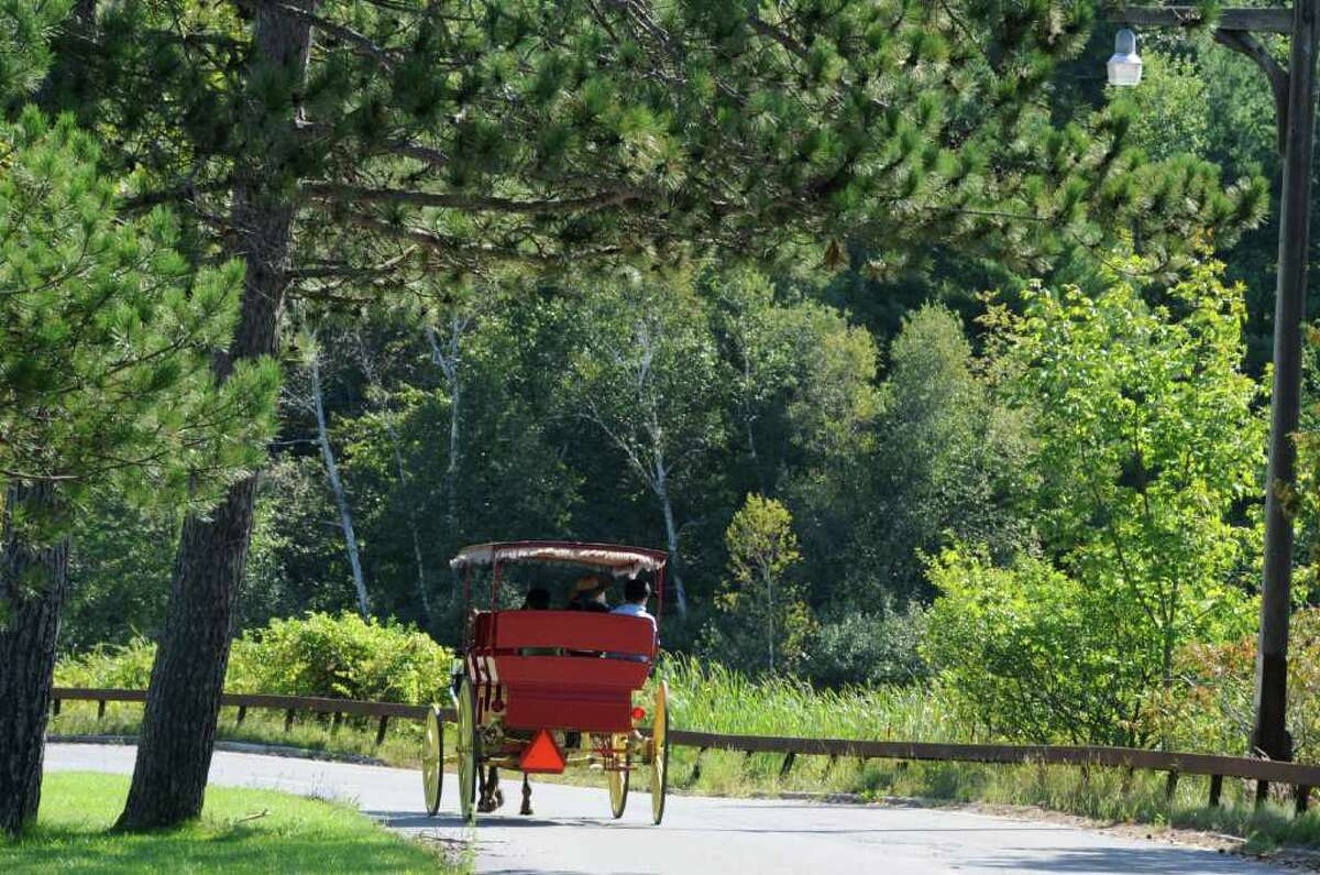 A horse and carriage bring tourists around Lake George Village, N.Y. Aug 30, 2011. (Skip Dickstein/ Times Union)