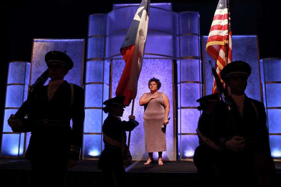 After singing the National Anthem, Rachel Cruz, owner of the International Academy of Music and the Arts, stands by during the  presentation and posting of the Colors by the John Jay High School Texas 782nd AFJROTC during the Brooks Field Legacy Salute at the Grand Hyatt Hotel in San Antonio on Tuesday, August 30, 2011. Photo: LISA KRANTZ, LISA KRANTZ/lkrantz@express-news.net / SAN ANTONIO EXPRESS-NEWS