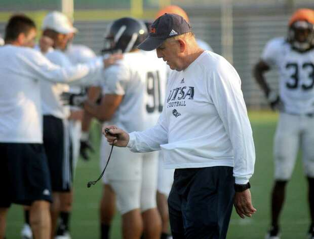 UTSA head coach Larry Coker observes a stopwatch during practice at Farris Stadium on Tuesday, Aug. 30, 2011. Photo: Billy Calzada/gcalzada@express-news.net / gcalzada@express-news.net