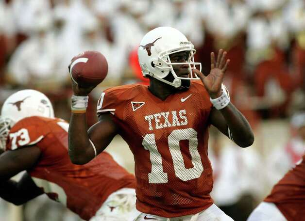 AUSTIN, TX - SEPTEMBER 17:  Quarterback Vince Young #10 of the Texas Longhorns looks to pass against the Rice Owls on September 17, 2005 at Darrell K Royal-Texas Memorial Stadium in Austin, Texas.  (Photo by Stephen Dunn/Getty Images) *** Local Caption *** Vince Young Photo: Stephen Dunn, Getty Images / Getty Images North America