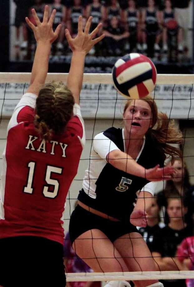 Katy's Colleen Payne (15) attempts a block over Kingwood's Alyssa Scherr during Tuesday night's matchup. Photo: Cody Duty, Houston Chronicle / © 2011 Houston Chronicle