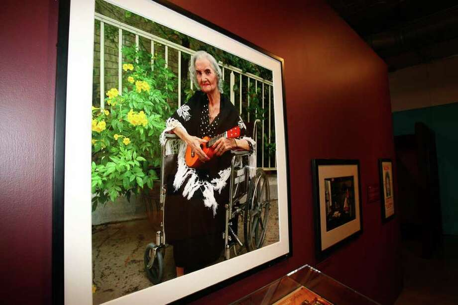 A portrait of Lydia Mendoza from 2004 is displayed at the  American Sabor exhibition at Museo Alameda with Eva Ybarra and Able Epstein.  June 25, 2009.  Photo: TOM REEL, Express-News / treel@express-news.net