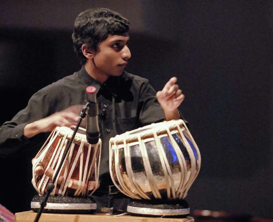 """BENEFIT CONCERT: Nitish Kulkarni performs percussion on the Indian tabla and conducts the orchestra of Cy-Fair student musicians during """"Fusion,"""" a concert to benefit Cy-Hope. Photo: Tony Bullard / Credit: for the Chronicle"""