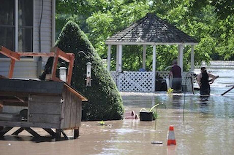 Residents at Riverside Place in Scotia work to salvage items. (Matthew Murdock)