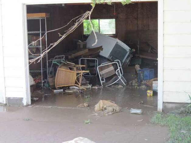 The inside of a garage on Main Street in Schoharie after Hurricane Irene.