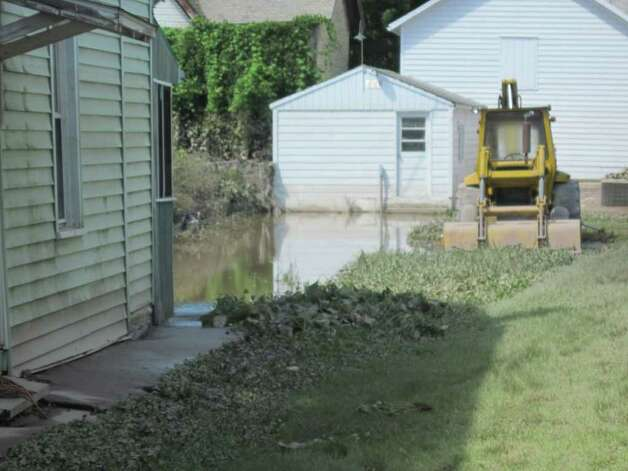 Stagnant water remains in the backyard of a business on Main Street in Schoharie after Hurricane Irene. (Christopher Lisio)