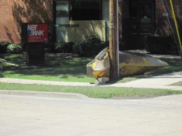 A kayak came to rest in front of NBT Bank in the village of Schoharie during historic flooding caused by Hurricane Irene. (Christopher Lisio)