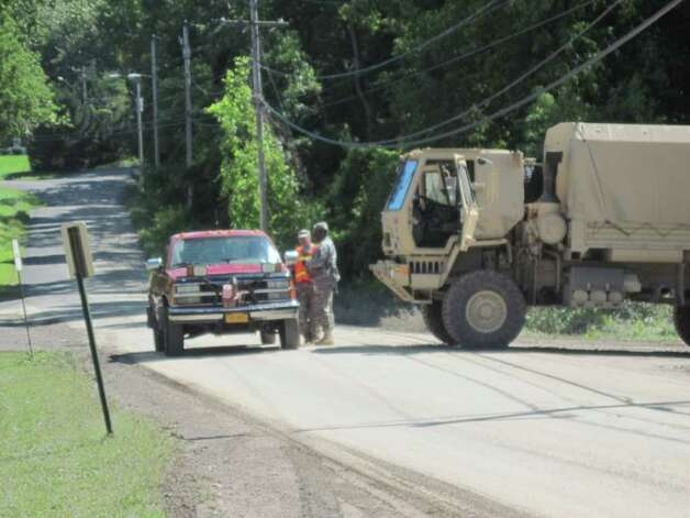 National Guard members block a road leading into the village of Schoharie after Hurricane Irene. (Christopher Lisio)
