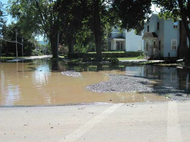 Stagnant water remains on the backstreets in the village of Schoharie following historic flooding caused by Hurricane Irene. (Jennifer Patterson)
