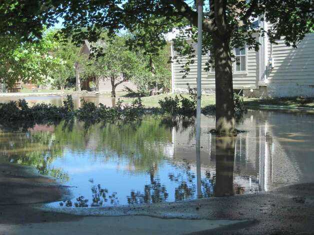 Some homes in the village of Schoharie were still underwater the day after historic flooding caused by Hurricane Irene ravaged the area. (Christopher Lisio)