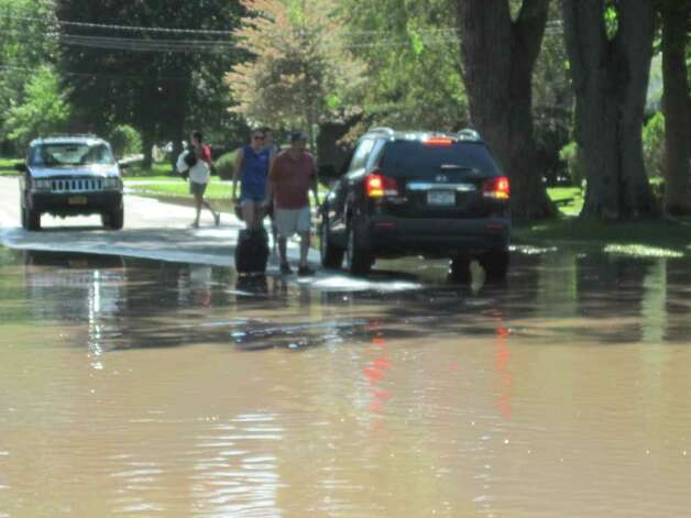 Schoharie residents carrying items salvaged from their flooded homes get a lift after epic flooding caused by Hurricane Irene. (Christopher Lisio)