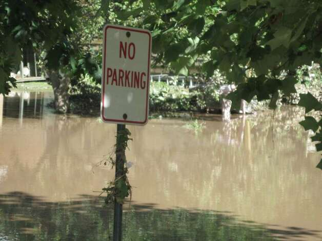 Flood waters still remained in the village of Schoharie the day after historic flooding caused by Hurricane Irene. (Jennifer Patterson)
