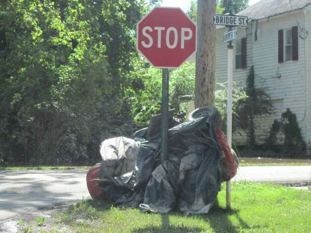 A lawnmower came to rest on a stop sign in the village of Schoharie after historic flooding caused by Hurricane Irene. (Christopher Lisio)